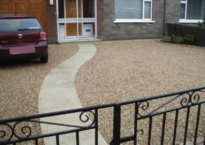 Completed gravel driveway with granite pathway and step